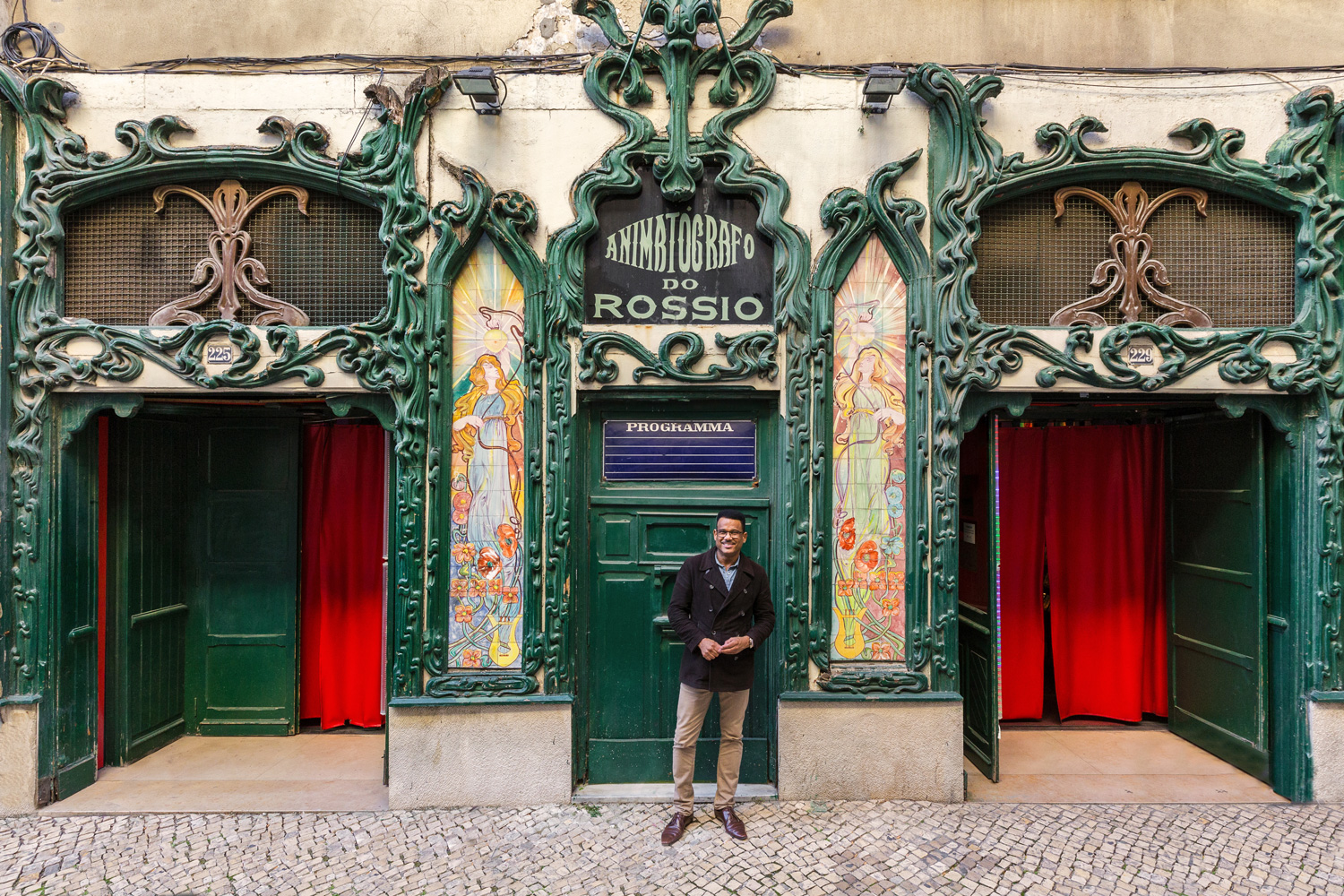 Manager José Antonio Almeida poses at the entrance of his business