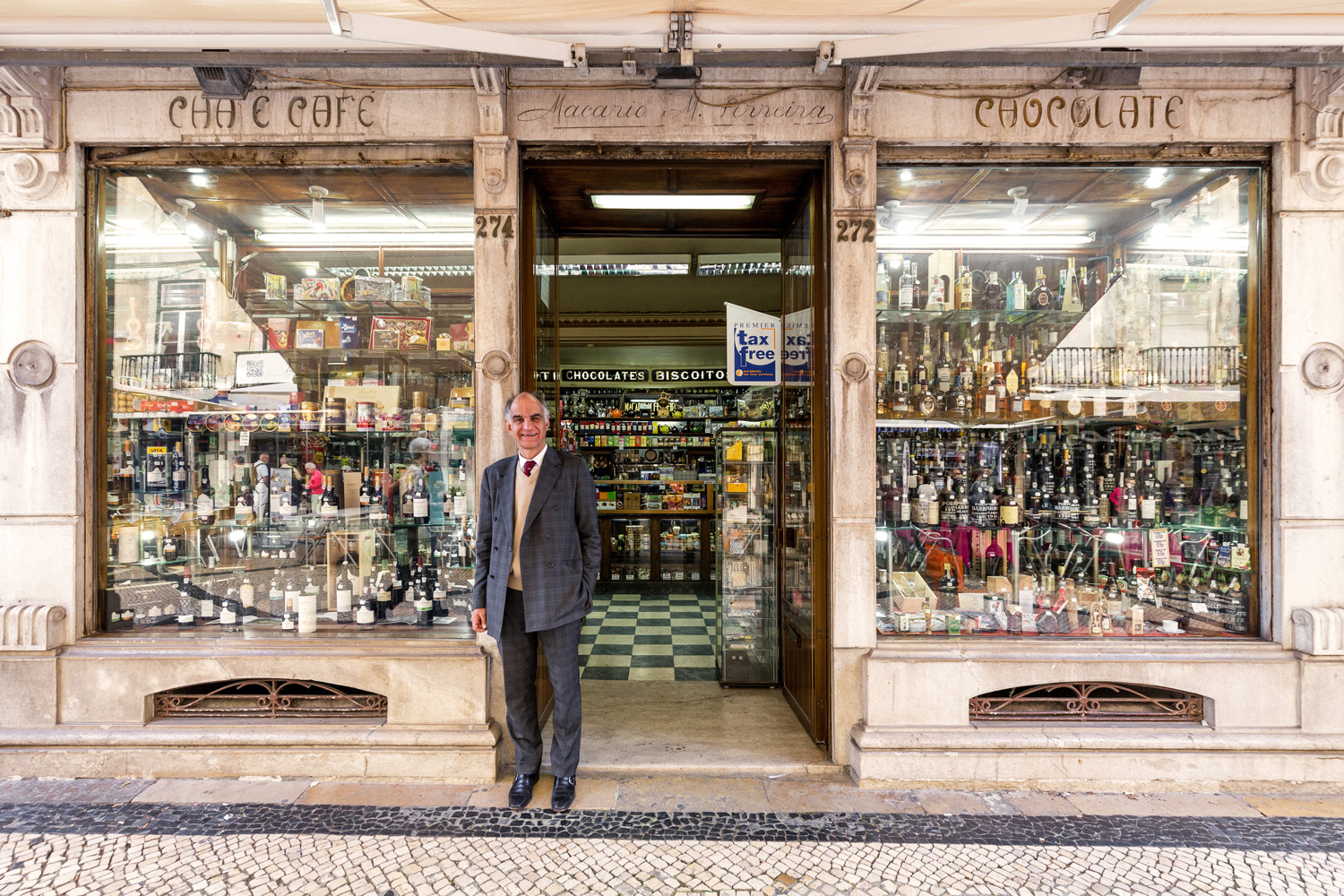 Luis Torres receives clients at the entrance of his delicatessen