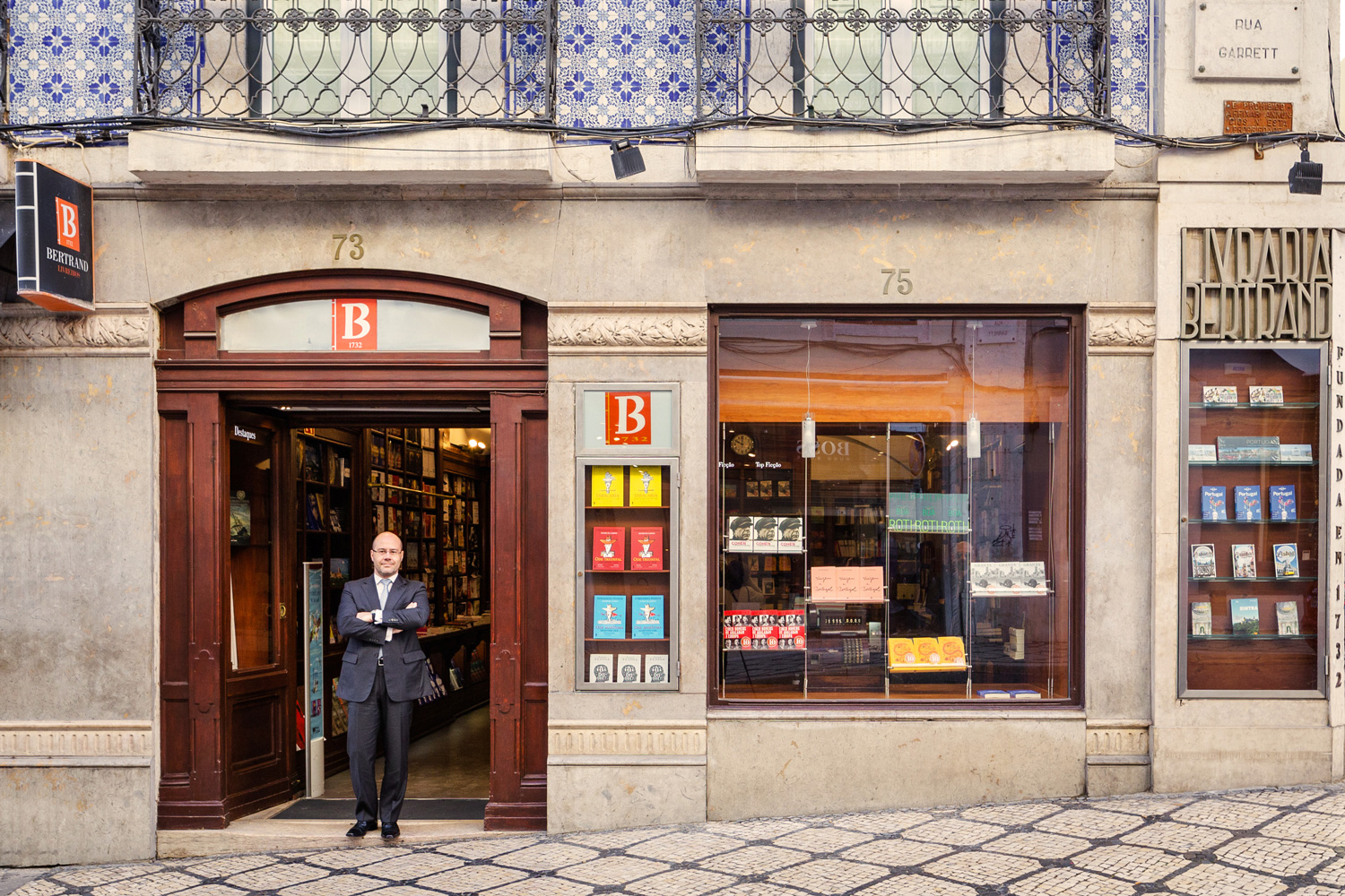 Bookseller Paulo Oliveira at the door of the global landmark