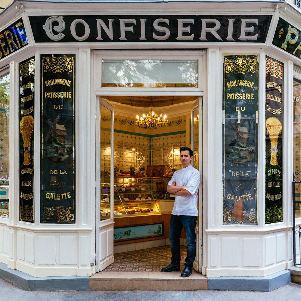 Boris Lumé, standing proudly at the entrance of his lovely bakery-confectionery