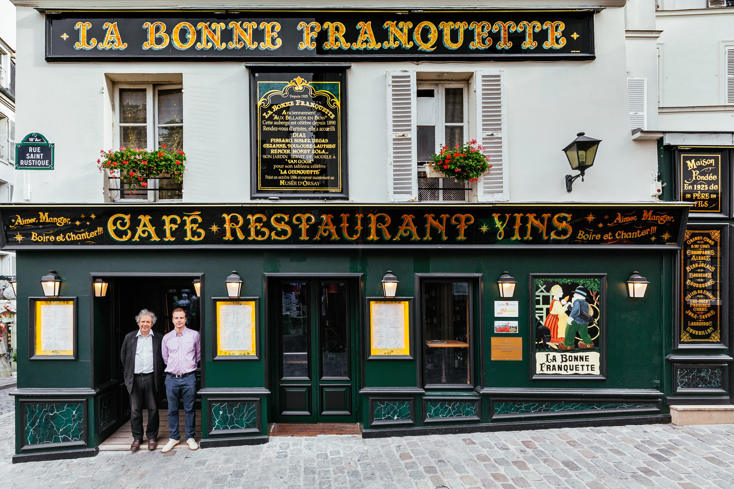 Luc Fracheboud and his father Patrick at the front door of their historic restaurant